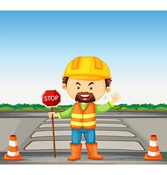 Road worker holding stop sign on the road vector