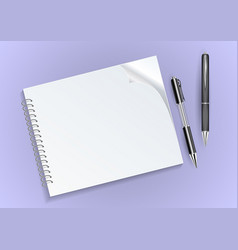 Notebook and pens vector
