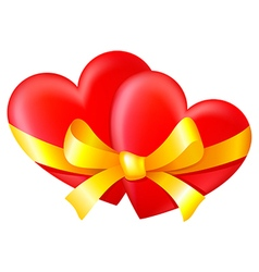 Two hearts tied with a gold ribbon with a bow vector image vector image