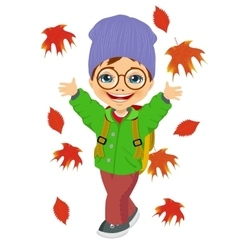 little boy playing with autumn leaves vector image vector image