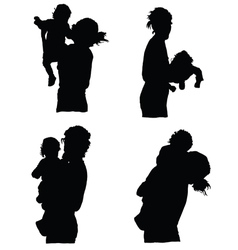 Mother holding baby silhouette vector
