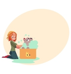 Red haired teenage girl washing bathing her dog vector