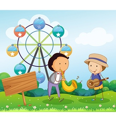 Two boys playing with musical instruments near the vector image