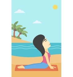 Woman practicing yoga upward dog pose on beach vector