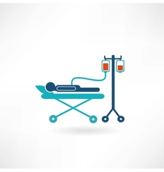 donor lies on a gurney and blood transfusions icon vector image