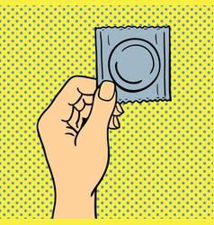 pop art hand with condom vector image