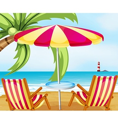 A chair and an umbrella at the beach vector