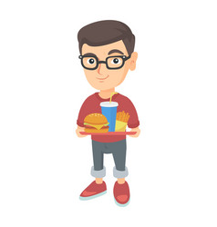 little caucasian boy holding tray with fast food vector image