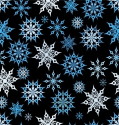 Seamless snowflakes on a dark background vector