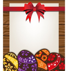 Painted Easter eggs on the wooden fence background vector image vector image