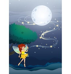 A night fairy with a yellow dress vector image