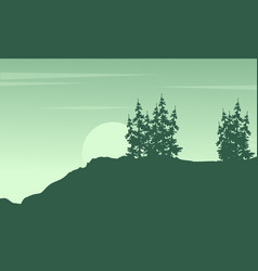Silhouette of tree on the cliff scenery vector