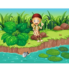 A girl sitting at the rock beside the river vector image