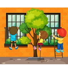 Three children climbing up the window vector image