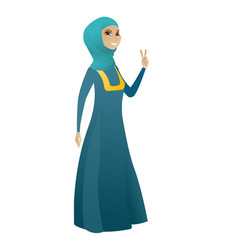 Muslim business woman showing victory gesture vector