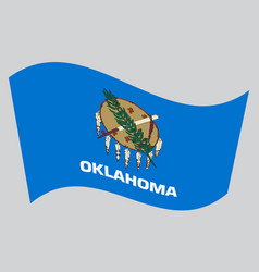 Flag of oklahoma waving on gray background vector