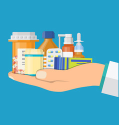 medical pills and bottles in hand of doctor vector image