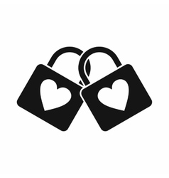 Two locked padlocks with hearts icon simple style vector