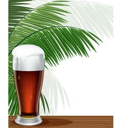Glass of beer and palm branches vector
