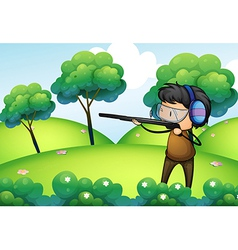 A man with a long gun at the top of the hill vector image vector image