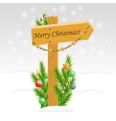 Wooden arrow with christmas toys with text vector