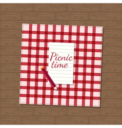 pencil and checkered fabric on wooden background vector image