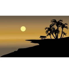 Silhouette of beach and hut vector