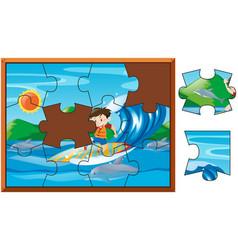 Jigsaw pieces of boy surfing in ocean vector