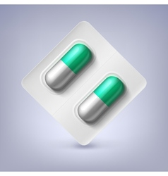 Green and white capsules in a blister pack vector