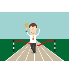 Businessman crossing finish line with trophy cup vector