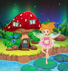A fairy flying beside a mushroom house vector