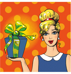 woman holding gift box pop art vector image vector image