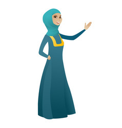 Muslim business woman showing a direction vector