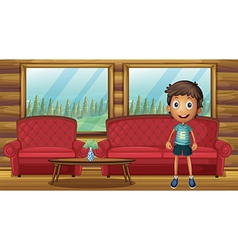 A boy standing inside the house vector image vector image