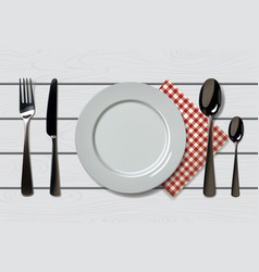 Empty realistic plate with spoon knife and fork vector