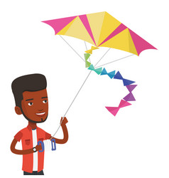 Young man flying kite vector