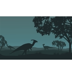 Silhouette of parasaurolophus walking in fields vector