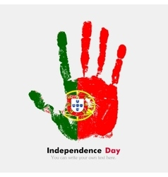 Handprint with the flag of portugal in grunge vector