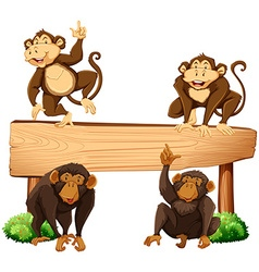 Four monkeys and wooden sign vector image