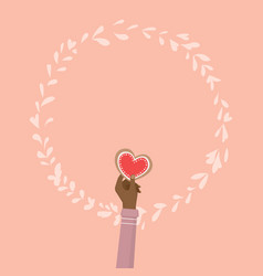 Hand holding heart cookie for valentines day vector