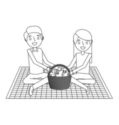 Couple parents sitting on blanket picnic and food vector