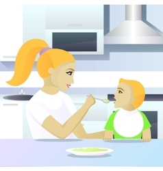 Mother feeding child in kitchen vector image