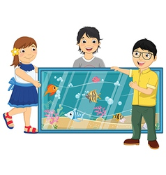 Of kids watching fishes in an vector