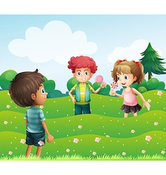 Three kids at the top of the hills vector