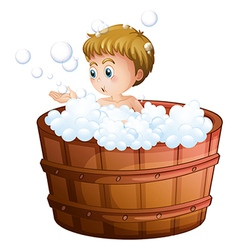 A boy playing with the bubbles inside the big vector image