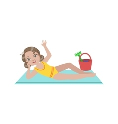 Girl on beach blanket with plastic bucket of toys vector
