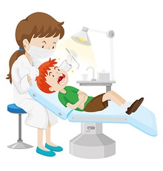 Boy having teeth checked by dentist vector