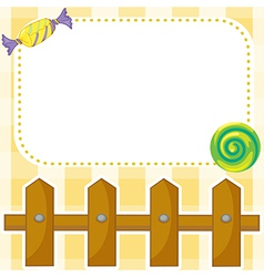 A stationery with candies and wooden fence vector image vector image