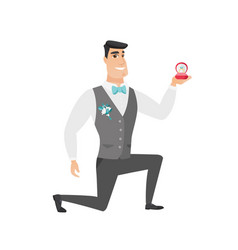 young groom holding wedding ring in box vector image