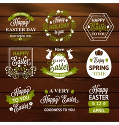 Easter labels and badges on wood background vector